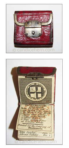 """London Almanack 1811 - 1 1/8"""" x 1 1/8"""" - Red leather wallet-style with steel latching mechanism, marbleized end papers, and an inside pocket."""