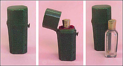 "Figure 6: Shagreen case (1 3/4"" tall) with brass fittings; lined in green paper and red velvet. Cut lead crystal bottle (1 1/2"" tall) with brass top over ground glass stopper. c1800."