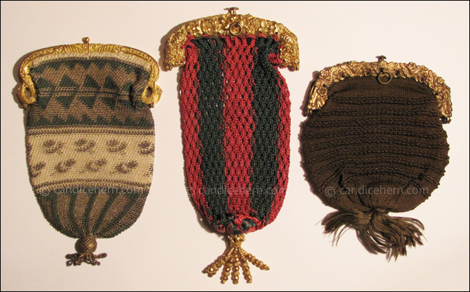 "Figure 3 Left:Small knitted purse of green and cream silk and gold metallic thread. The gilt frame is decorated with horns of plenty and twisting griffin heads. The purse is tied at the bottom with a gold bead and tassel of gold wire shaped into tiny coils. 3 ¾"" long, from frame to tassel bead. c1810. Center: Crocheted purse of red and dark green silk, attached to an earlier gilt frame. The purse is tied at the bottom with a tassel of gold beads. 4"" long, from frame to tassel bead.  c1825. Right: Knitted purse of dark green silk attached to a pinchbeck frame decorated with flowers. The silk is gathered and tied into a tassel at the bottom of the purse. 3"" long from frame to tassel knot. c1815."