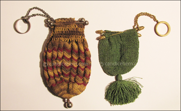 "Figure 4 Left: Small knitted tubular purse with a flamestitch pattern highlighted with gold metallic thread. Silvered opening bars attached to a silvered finger-ring, and a silvered ball hangs from the bottom of the purse. 3"" long, from bar to tassel bead. c1800.  Right: Tiny purse of finely netted green silk. Gilt opening bars with acorns at the ends are attached to a gilt finger-ring. Silk is gathered and tied into a tassel at the bottom of the purse. 2"" long, from bar to tassel knot. c1795."